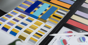 color swatches and sketches on table for rebranding your business